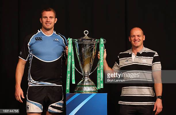 Glasgow Warriors Captain Alastair Kellock poses with Director of Rugby Gregor Townsend and the Heineken Cup trophy during the UK Heineken Cup and...