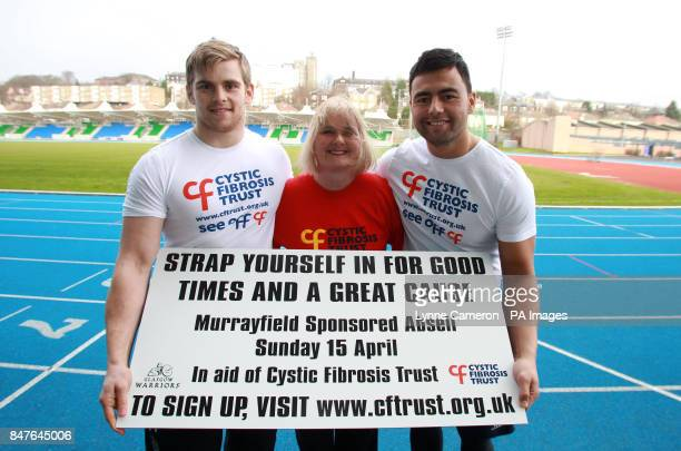 Glasgow Warrior's Pat MacArthur and Troy Nathan pose with Cystic Fibrosis Trust's June Ross as they promote a sponsored abseil at Scotstoun Stadium...