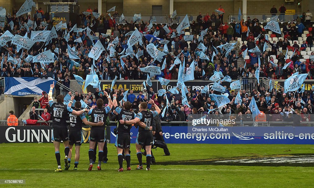 Glasgow Warriors players celebrate in front of their fans after the Guinness Pro 12 final match between Munster and Glasgow Warriors at Kingspan...