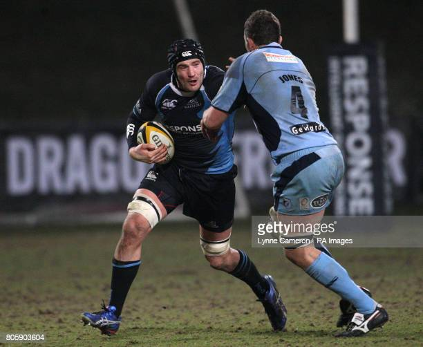 Glasgow Warriors' Tim Barker is tackled by Cardiff Blues' Deiniol Jones
