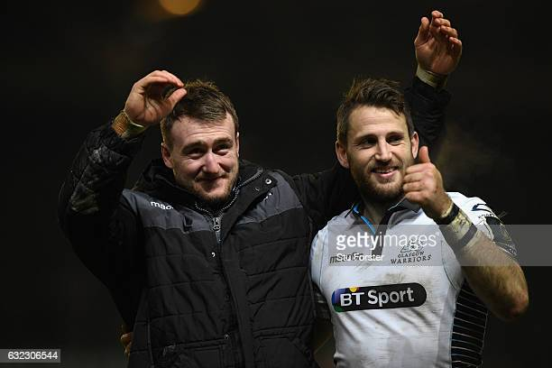 Glasgow wing Tommy Seymour and Stuart Hogg celebrate after the European Rugby Champions Cup match between Leicester Tigers and Glasgow Warriors at...