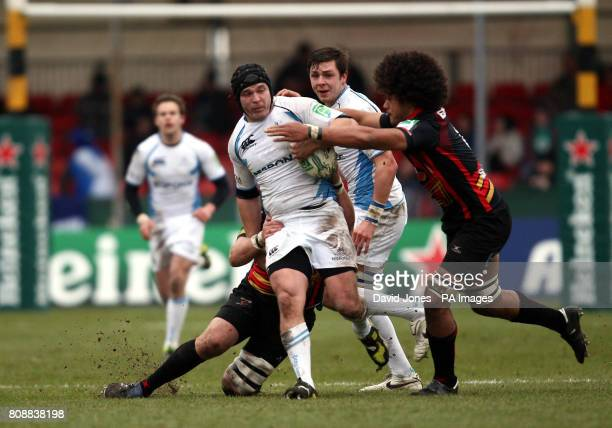 Glasgow's Dougie Hall is tackled by Newport Gwent Dragons' Toby Faletau during the Heineken Cup match at Rodney Parade Newport
