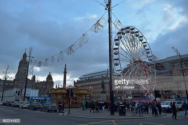 Glasgows fairground rides and Christmas lights are turned off in memory of the victims of the bin lorry tragedy which happened on 22 December 2014...