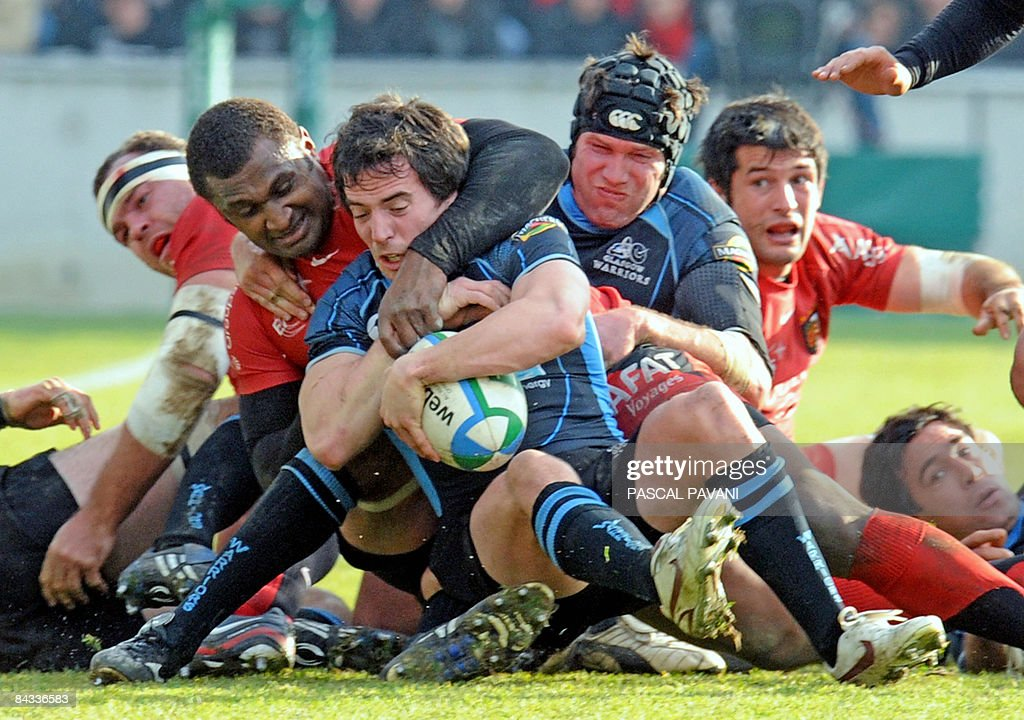 Glasgow's scrumhalf Colin Gregor is tackled by Toulouse's centre Maleil Kunavore during their European Cup rugby match Toulouse versus Glasgow on...