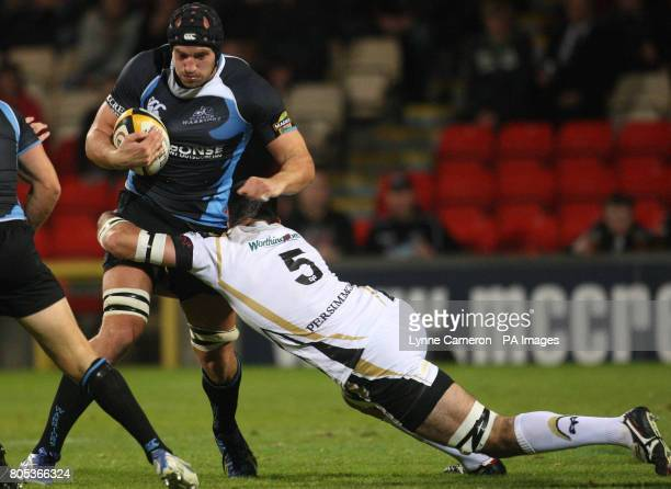 Glasgow's Tim Barker and Ospreys Andy Lloyd in action during the Magners League match at Firhill Arena Glasgow