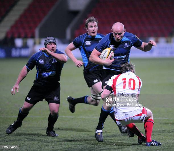 Glasgow's Tim Barker runs at the Ulster defence during the Magners League match at Firhill Glasgow