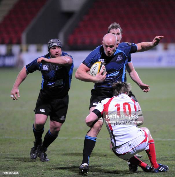 Glasgow's Tim Barker runs at the Ulster defence