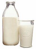 A glass and quart bottle of milk