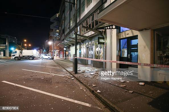 Glass and rubble covers the footpath on Wakefield Street after an earthquake on November 14 2016 in Wellington New Zealand The 75 magnitude...