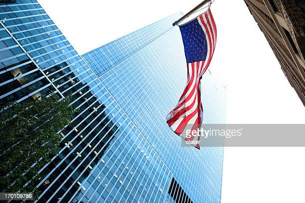 Glass and steel building, american flag