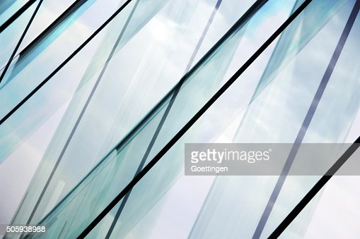 Glass architecture. Double-exposure tilt photo of contemporary office building facade. : Stock Photo