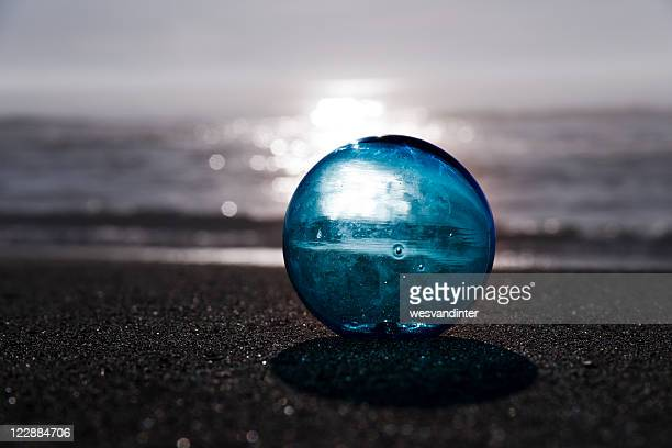 Glass Ball on Beach at Sunrise/Sunset