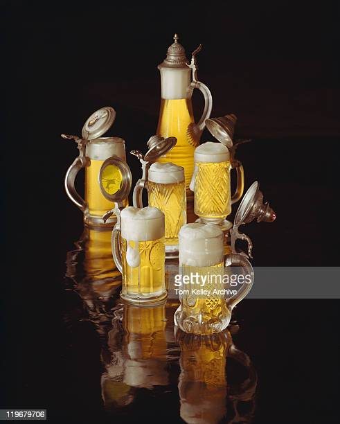 Glass beer stein with beer on black background