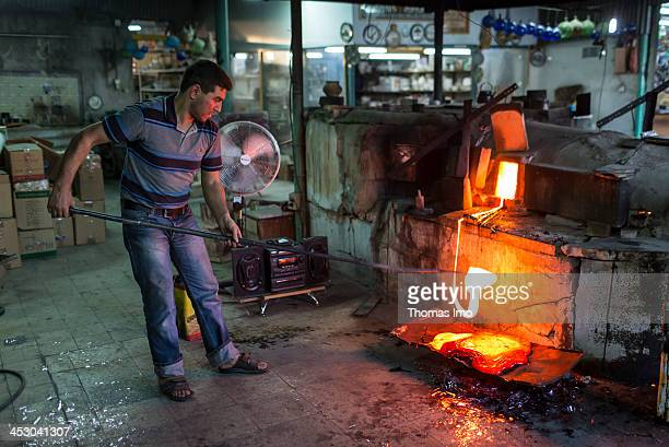A glass blower at work at the Al Salam factory on November 03 2013 in Hebron The Palestinian Territories