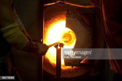 Blowing glass glory hole