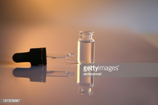 glass bottle and pipette