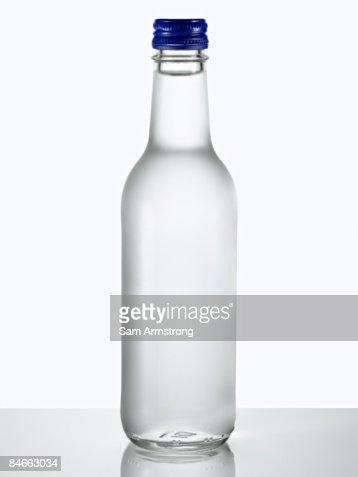 Glass bottle of water.