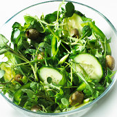 Glass bowl of green salad