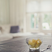 Glass bowl of pineapple chunks