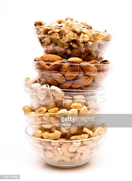 Glass bowls with almonds, cashew nuts, pistachios, peanuts