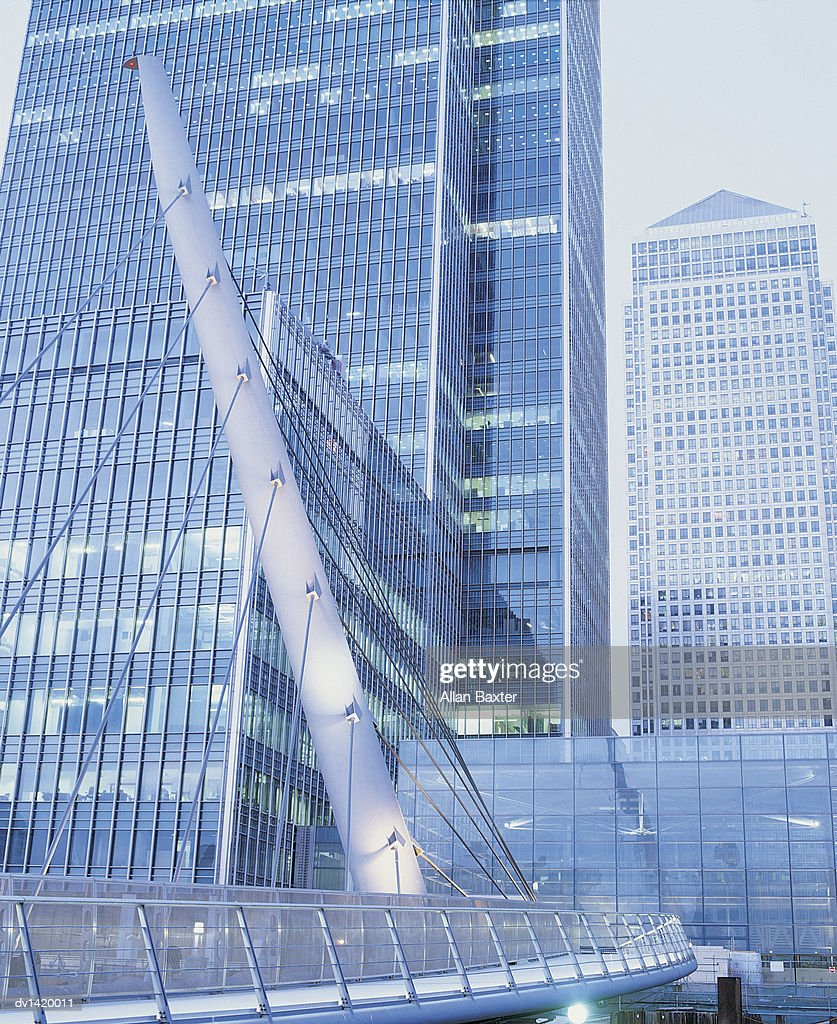 Glass Building Exteriors,  Canada Tower and the Wilkinson Bridge, Canary Wharf, London : Stock Photo