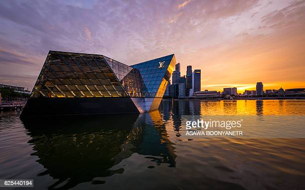 Glass building Louis vitton island maison  in a sunset at marina bay