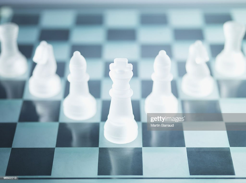 Glass chess pieces on glass chess board : Stock Photo