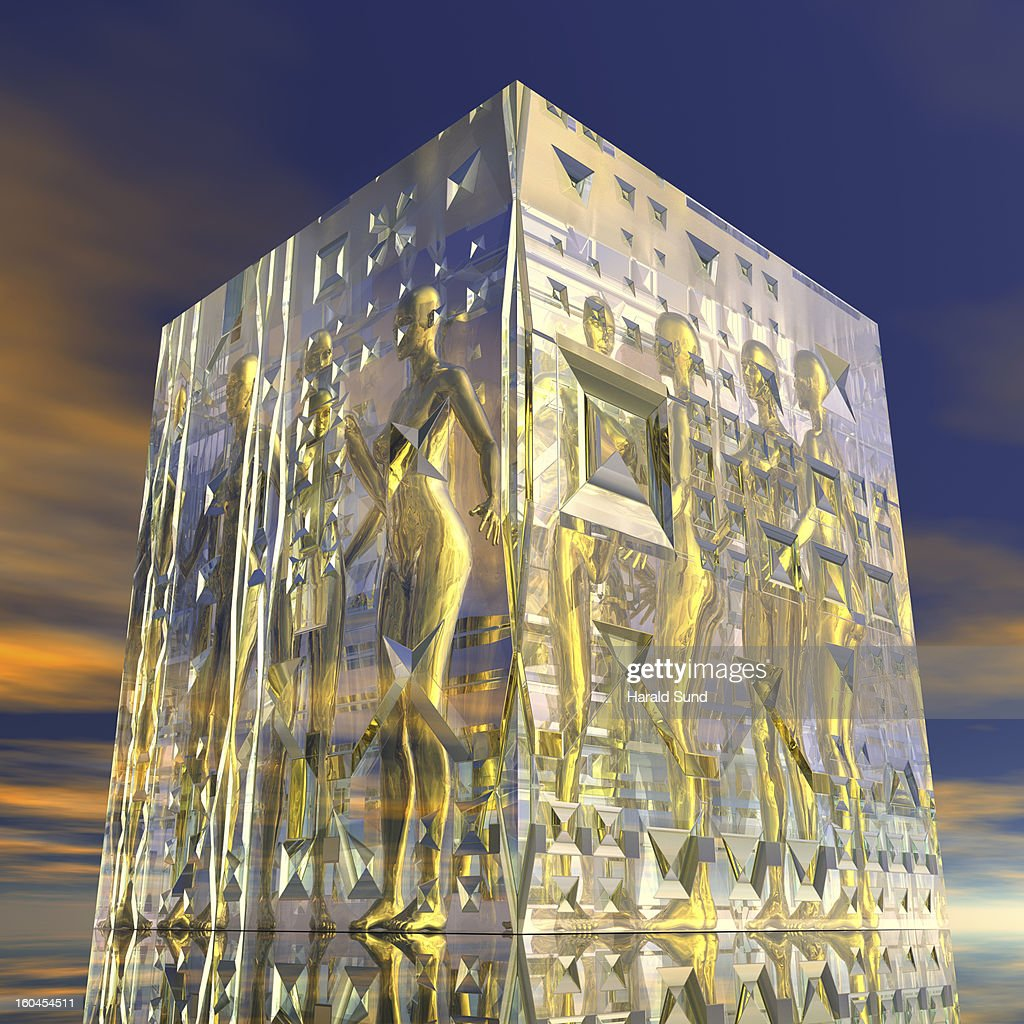 Glass cube with encased female nude figures : Stock Photo