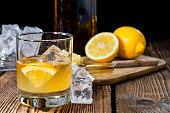 Fresh made Cocktail (Whiskey Sour) on dark wooden background