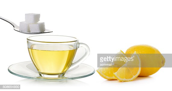 Glass cup of  lemon tea and sugar isolated : Stock Photo