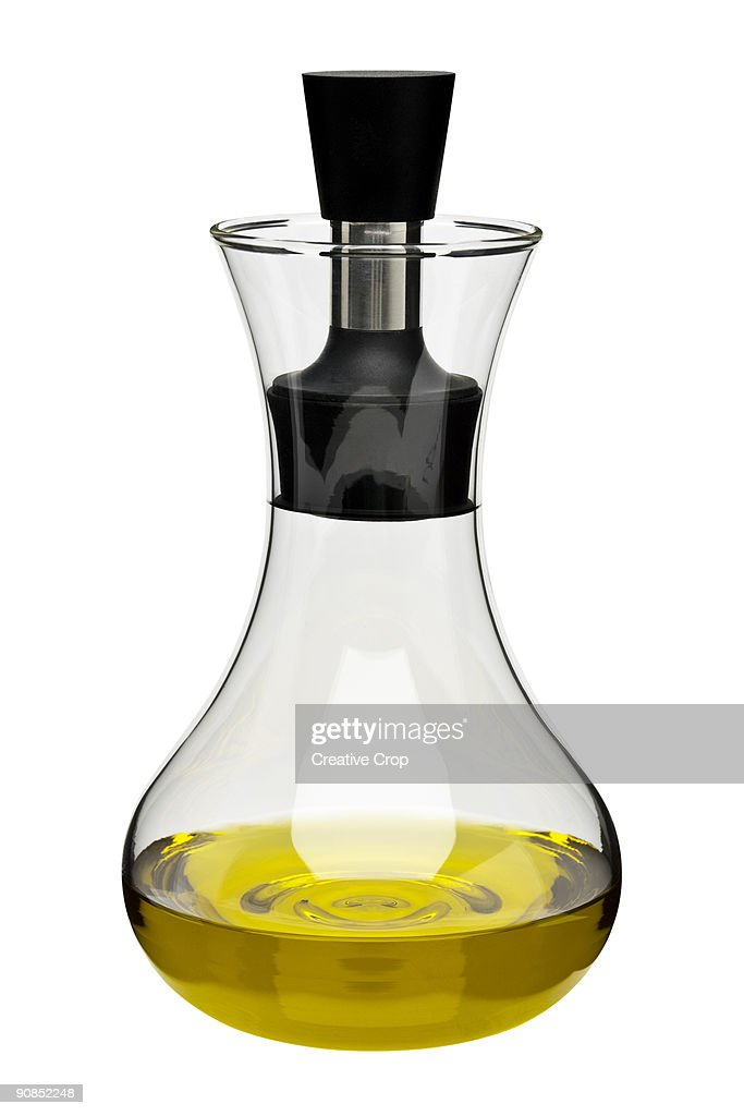 Glass decanter containing olive oil : Stock Photo