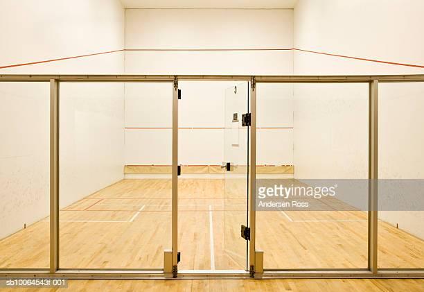 Glass door entrance onto empty squash court