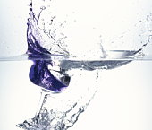 Glass dropped in water, white background