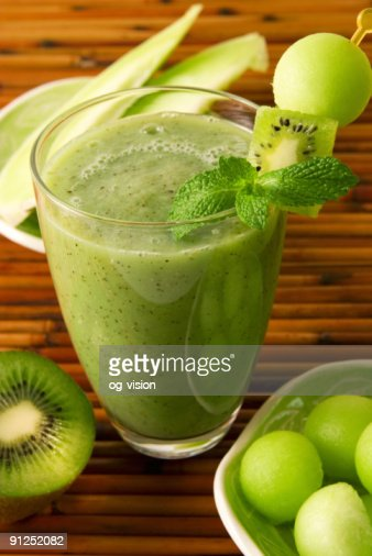 Glass full of green kiwi honeydew smoothie : Stock Photo