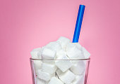 Glass full of sugar cubes - unhealthy diet concept