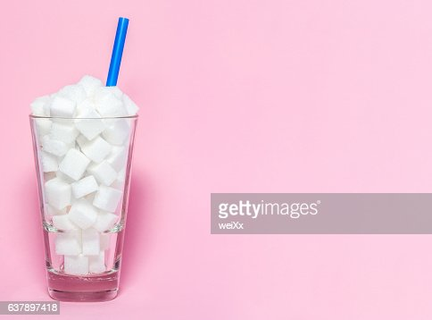 Glass full of sugar cubes - unhealthy diet concept. : Foto de stock