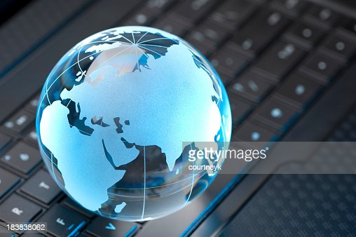 Glass Globe and Computer Keyboard