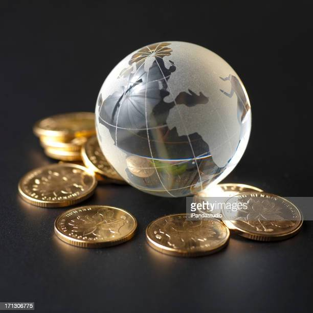 Glass globe and golden coins