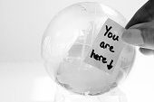 b&w image of clear glass world or globe with a message