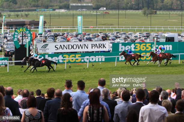 Glass Harmonium and Redwood race for the line during The bet365 Gordon Richards Stakesd during Gold Cup Day at Sandown Park