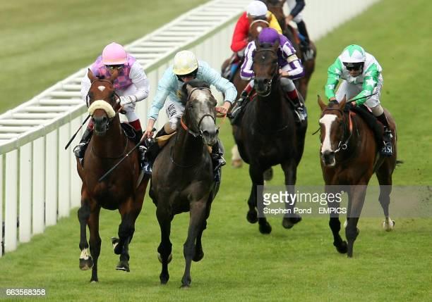 Glass Harmonium ridden by jockey Ryan Moore wins the Hampton Court Stakes on Ladies' Day at Royal Ascot