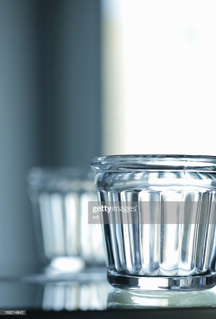 Glass in front of mirror : Stock Photo
