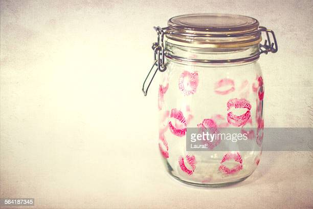 Glass jar covered in  lipstick kisses
