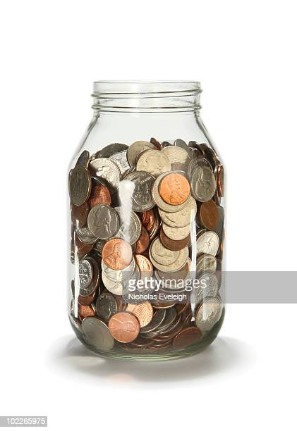 Glass jar filled with loose coins USD