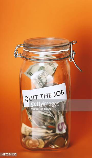 Glass jar with dollars and 'quit the job' text