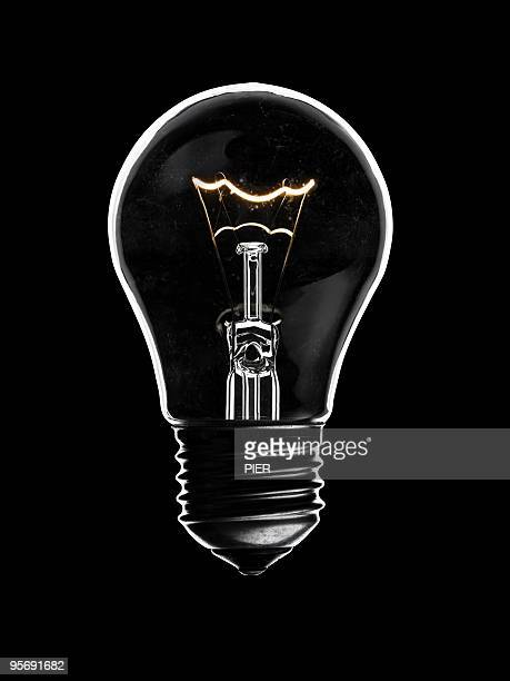 Glass light bulb with glowing elements