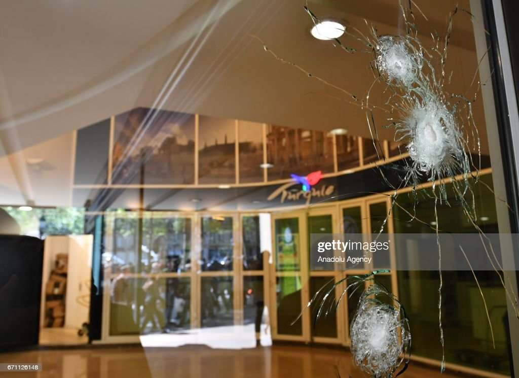 Glass made doors hit where the police officer shot dead by terrorist attack at the Champs-Elysees in Paris, France on April 21, 2017.
