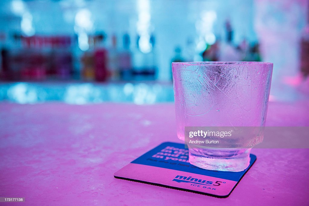A glass made entirely of ice sits on the bar of Minus5 Ice Bar during a media preview on July 9, 2013 in New York City. The bar, which opened yesterday, is built from 90 tons of ice, kept at 23 degrees Fahrenheit, or minus 5 degrees Celsius, and can hold 55 people.