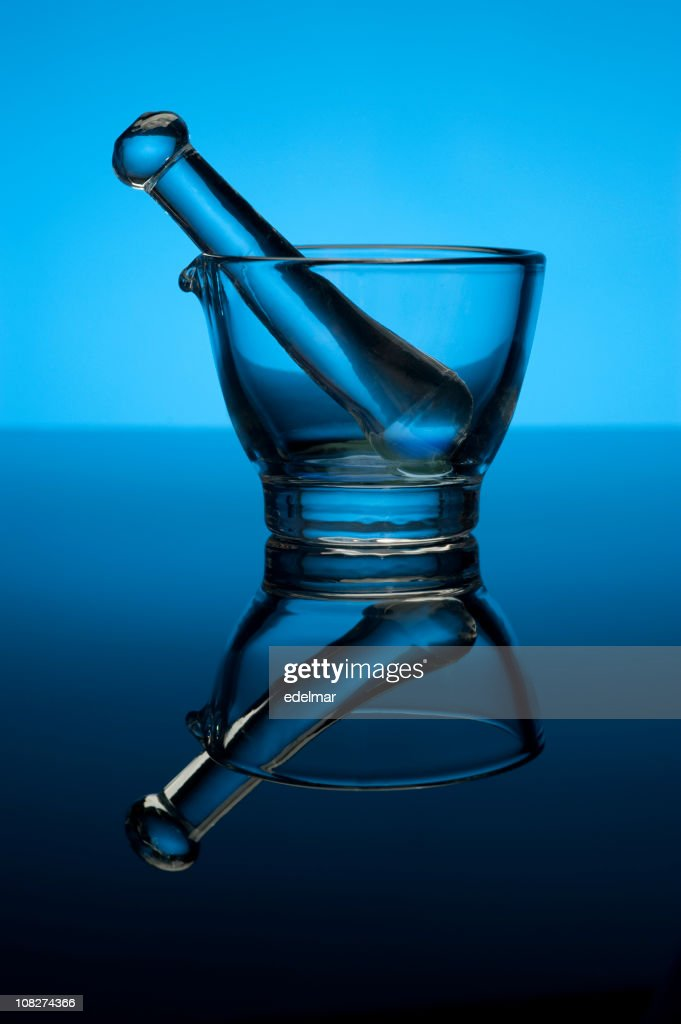 Glass Mortar and Pestle on Blue Background : Stock Photo
