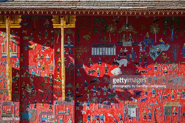 Glass mosaic at wat xieng thong temple wall, Luang